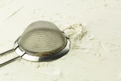 Sifter. On the white flour Royalty Free Stock Photography