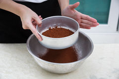 Sifting cocoa powder Royalty Free Stock Image