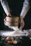 Sifting Flour By Female Hands Royalty Free Stock Image