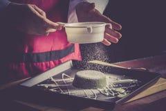 Sifting flour Stock Photography