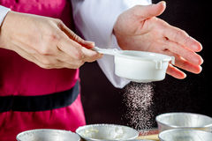 Sifting flour Stock Images
