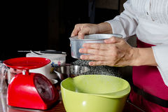 Sifting flour Royalty Free Stock Photography
