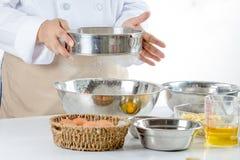 Sifting flour Royalty Free Stock Image