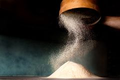 Sifting flour from old sieve. Sifting flour from old sieve for make pizza Royalty Free Stock Image
