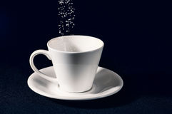 Sifting  sugar in the cup Stock Photography