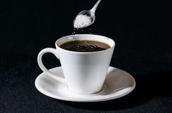 Sifting  sugar in the cup Royalty Free Stock Image