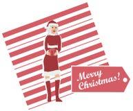 Sig.ra Claus Holding un regalo spostato Immagine Stock