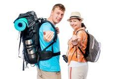 Siga-nos! Um par turistas são convidados a ir acampar imagens de stock royalty free