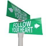 Siga seu coração - sinal de rua em dois sentidos Imagens de Stock Royalty Free