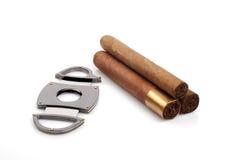 Sigaren en een open snijder stock afbeelding