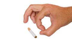 Sigaretta di rifiuto della gente. Fotografia Stock