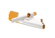 Sigaretta su una priorità bassa bianca. Non fumatori Fotografia Stock