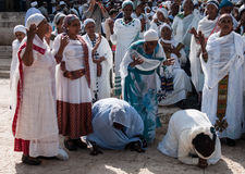 Sigd - An Ethiopian Jews Holyday. JERUSALEM - OCT 31: Ethiopian Jewish women kneel in pray at the Sigd - Oct. 31, 2013 in Jerusalem, Israel. The Sigd is an Stock Photography