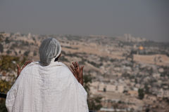 Sigd - An Ethiopian Jews Holyday. JERUSALEM - OCT 31: Ethiopian Jewish woman prays, facing the old city, at the Sigd - Oct. 31, 2013 in Jerusalem, Israel. The Stock Photography