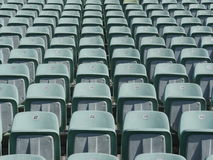 Sièges verts de stade Image libre de droits