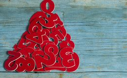 Sigh symbol Christmas tree from many random numbers. On old retro vintage style wooden texture background Royalty Free Stock Images