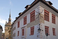Sighisoara bell clock tower and Casa cu cerb Royalty Free Stock Images