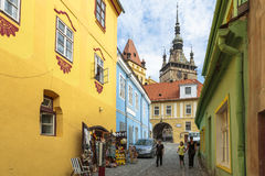 Sighisoara medieval citadel, Romania. Unidentified tourists visit the medieval citadel of Sighisoara, listed by UNESCO as World Heritage Site. Vlad Tepes ( royalty free stock image