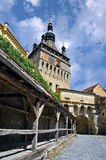 Sighisoara, Romania. Street view in Medieval city of Sighisoara with clock tower and city gate, Romania stock image