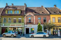 Sighisoara in Romania. Sighisoara, Romania - July 4, 2016: Row of old town houses on the 1st December 1918 Street in Sighisoara city royalty free stock photography