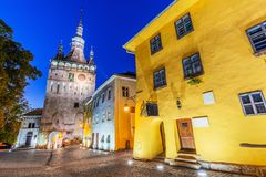 Sighisoara, Romania. Medieval street with Clock Tower and house of Dracula in Transylvania royalty free stock photography