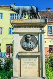 Sighisoara in Romania. Sighisoara, Romania - July 4, 2016: Sculpture of Capitoline Wolf on the Old Town of Sighisoara stock images