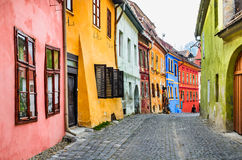 Sighisoara, Romania. Stone paved old streets with colorful houses in Sighisoara fortress, Transylvania region of Europe Stock Image