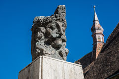 Sighisoara in Romania. Vlad the Impaler statue next to Monastery Church in Sighisoara town in Romania Royalty Free Stock Image