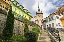 Sighisoara stairway. A snapshot of the old buildings in Sighisoara,  alongside the old city clock tower Royalty Free Stock Images