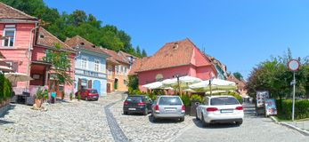 Sighisoara street with colorful medieval buildings Stock Photos