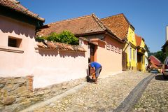 Sighisoara street with colorful medieval buildings. Street with painted buildings in the medieval citadel of Sighisoara, Transylvania, Romania. Sighisoara is the Royalty Free Stock Photos