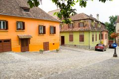 Sighisoara street with colorful medieval buildings Royalty Free Stock Photos