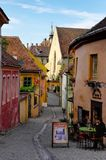 Sighisoara - typical narrow street of old city Royalty Free Stock Images