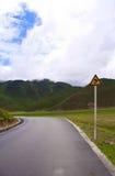 Sighn indicating a right turn of a road Royalty Free Stock Photos