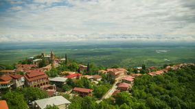 Sighnaghi, Georgia. Panoramic view on the city landscape. Time lapse. The clouds float above the mountains stock video footage