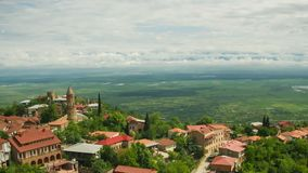 Sighnaghi, Georgia. Panoramic View on the City Landscape. Timelapse. The clouds float above the mountains stock footage