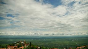 Sighnaghi, Georgia. Panoramic View on the City Landscape. Timelapse. The clouds float above the mountains stock video footage