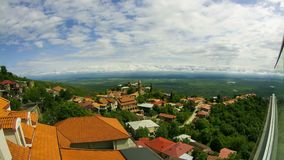 Sighnaghi, Georgia. Panoramic View on the City Landscape. Timelapse. The clouds float above the mountains stock video