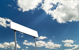 Sighpost with bright blue cloudy sky Stock Photos