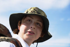 Sight of the boy in a hat. The boy looks with astonishment and cheerfully forward Stock Images