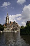Sight of Bruges along water canal Royalty Free Stock Images