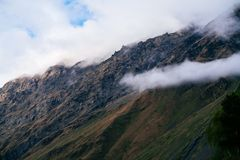 Sight of Caucasus mountains near Kazbegi, Georgia on a foggy day stock photo