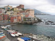 Sight of the city of Boccadasse an old mariners` neighbourhoodon with ugly time, Liguria Italy. Sight of the city of Boccadasse old mariners` neighbourhoodon Royalty Free Stock Photo