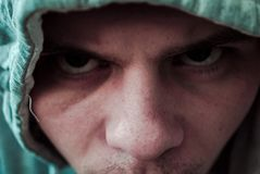 Sight of an evil men in the hood stock images