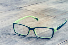 Sight glasses on bamboo floor in vintage Stock Images