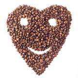 Sight 'Heart' with face from Coffee beans. On white isolated background Royalty Free Stock Images