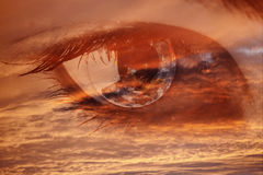 A sight from heaven. Female clear eye in clouds fantasy concept royalty free stock image