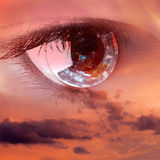 A sight from heaven. Female clear eye in clouds fantasy concept Stock Image