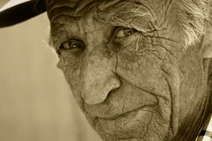 Sight of the old man. Face of the old person, in wrinkles Royalty Free Stock Image
