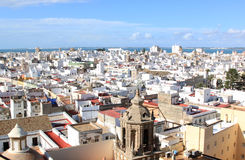 Sight over Cadiz from the cathedral, Spain. Sight from Poniente Tower, one of the towers of Cadiz Cathedral, upon the town and the Atlantic Ocean. In the front Stock Photos